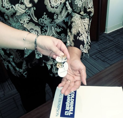 Essie James accepts at closing the keys to her home on Ohio Avenue.
