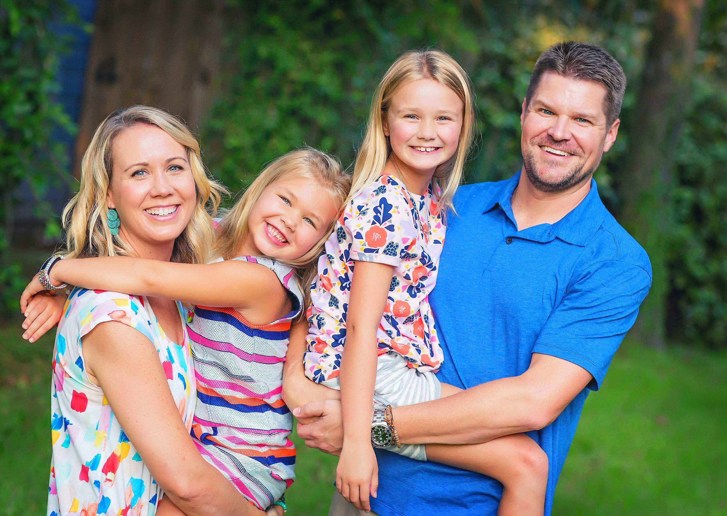 Family portrait in colorful and vibrant clothing by family photographer spryART photography in The Woodlands, Texas.