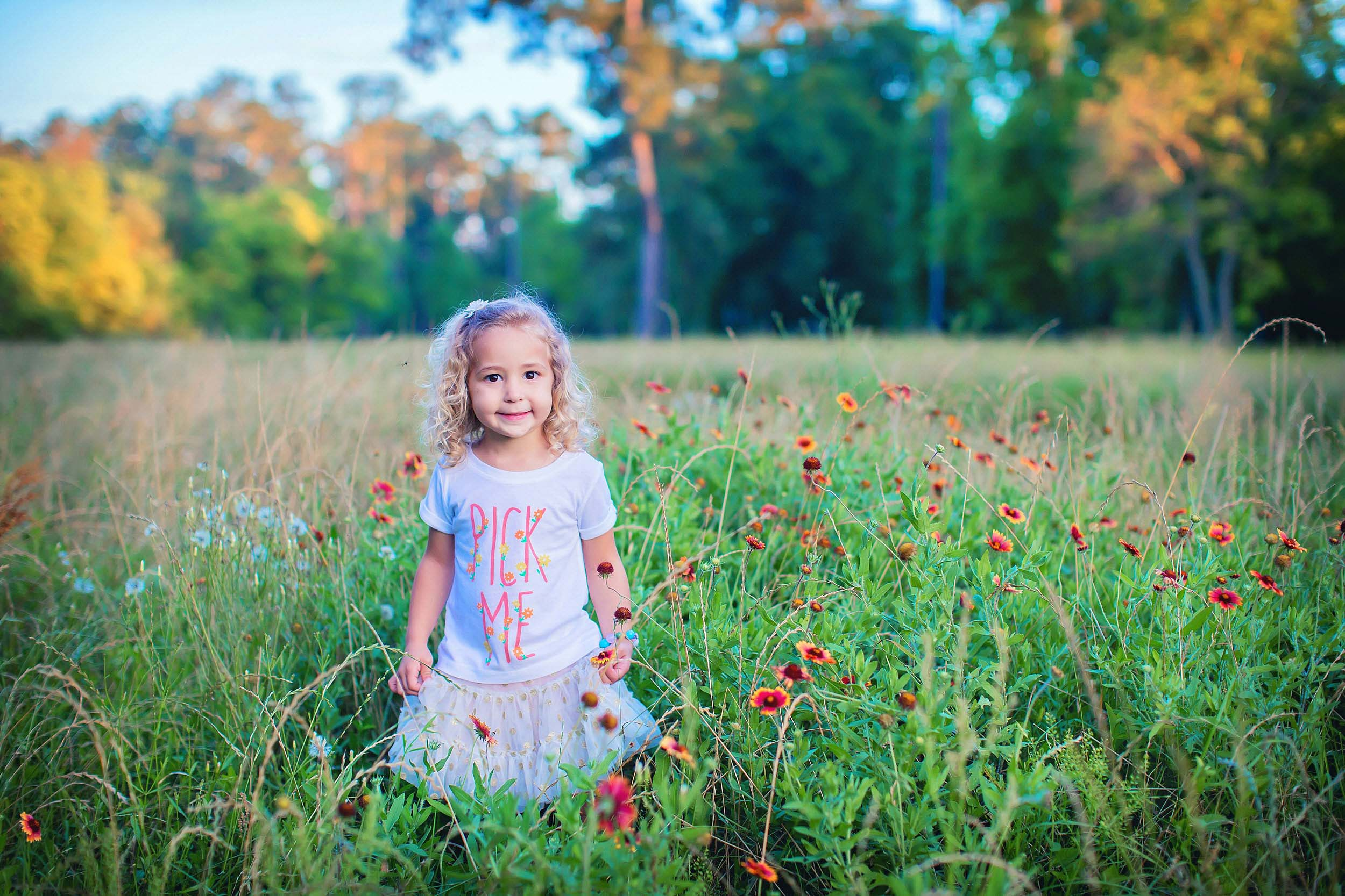 Portrait of lIttle girl standing in wildflowers in The Woodlands, Texas