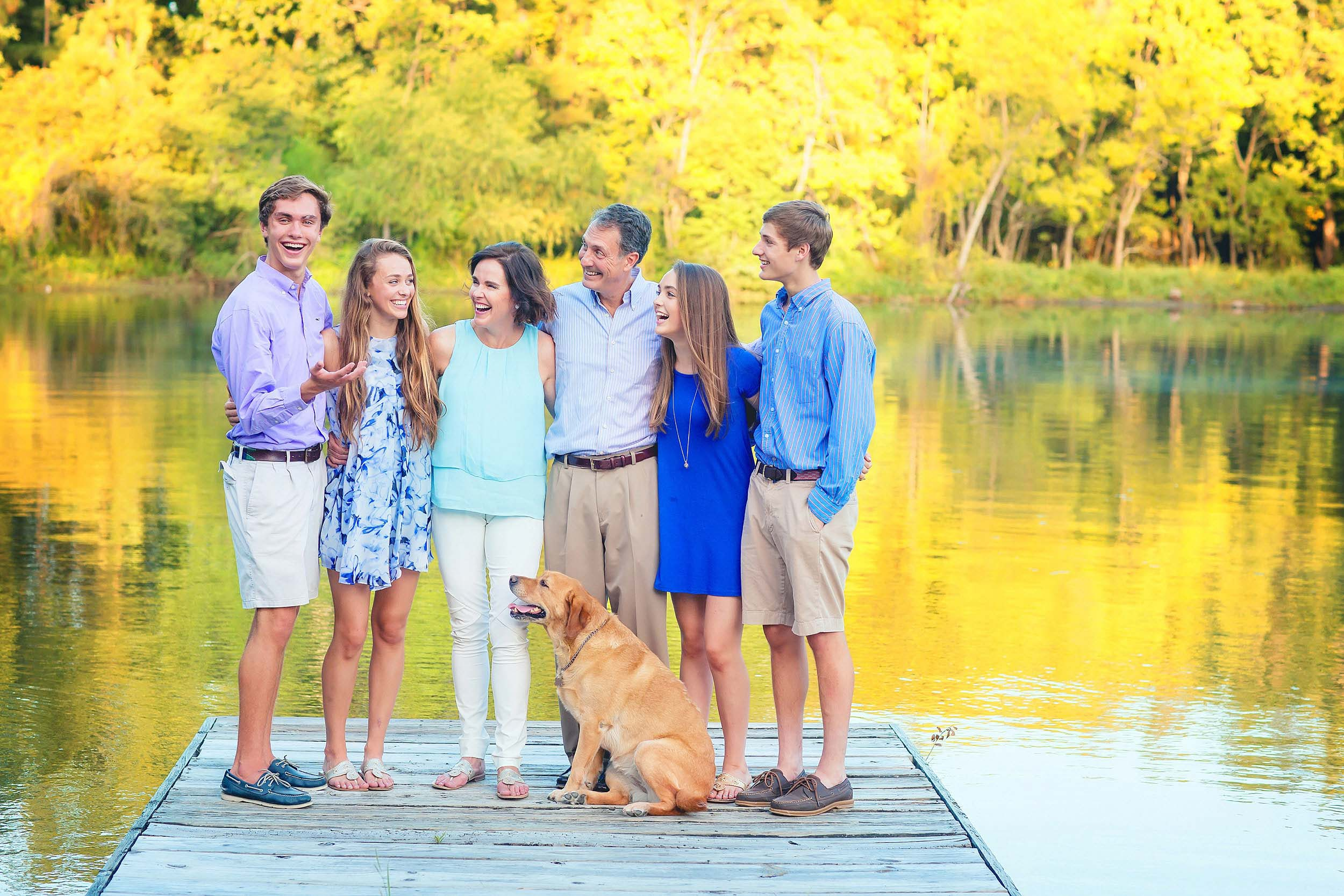 Fun family portrait with teenagers and dog in The Woodlands, Texas by spryART photography.