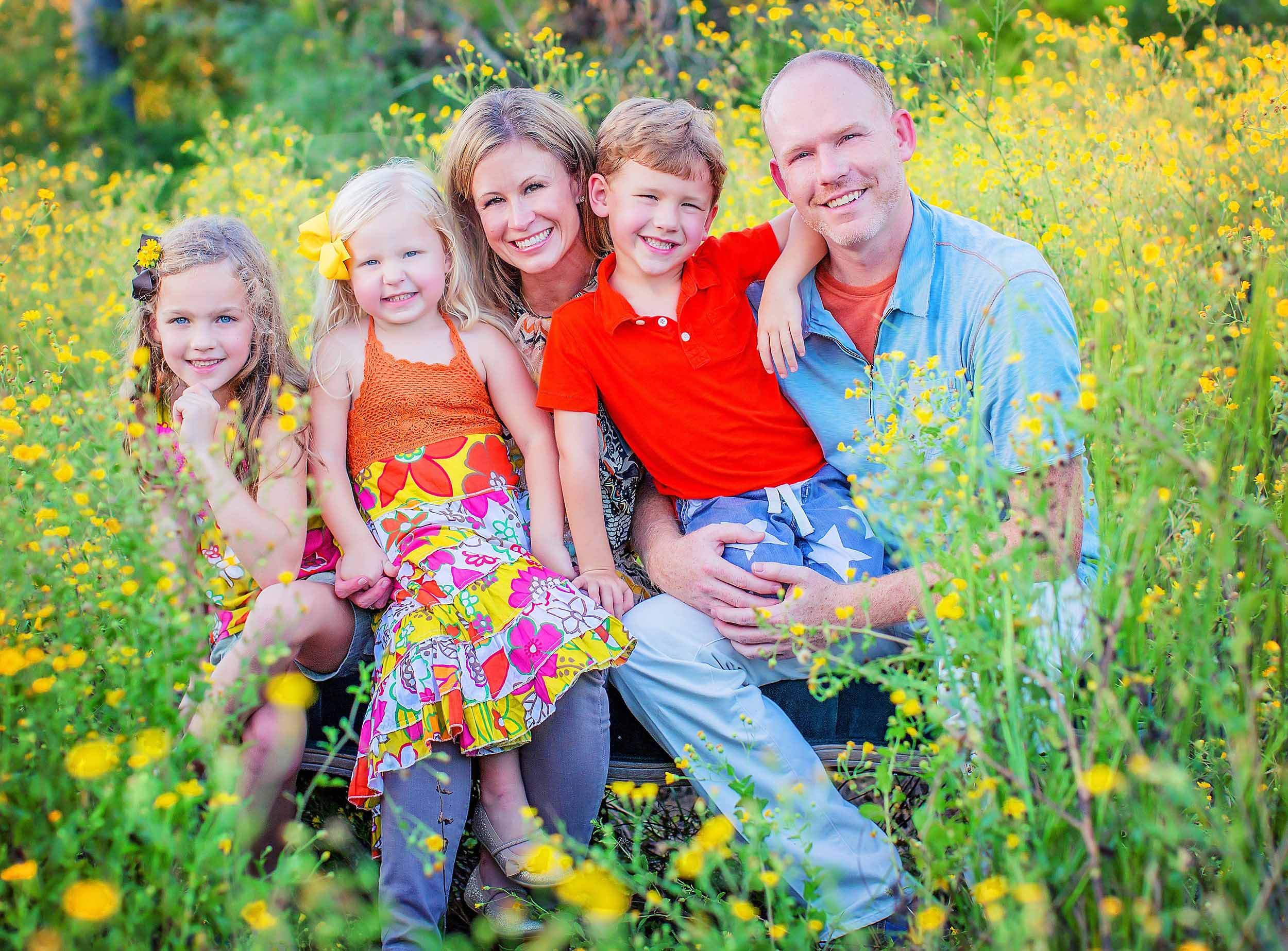 Family photograph in wildflowers in The Woodlands, Texas by spryART photography