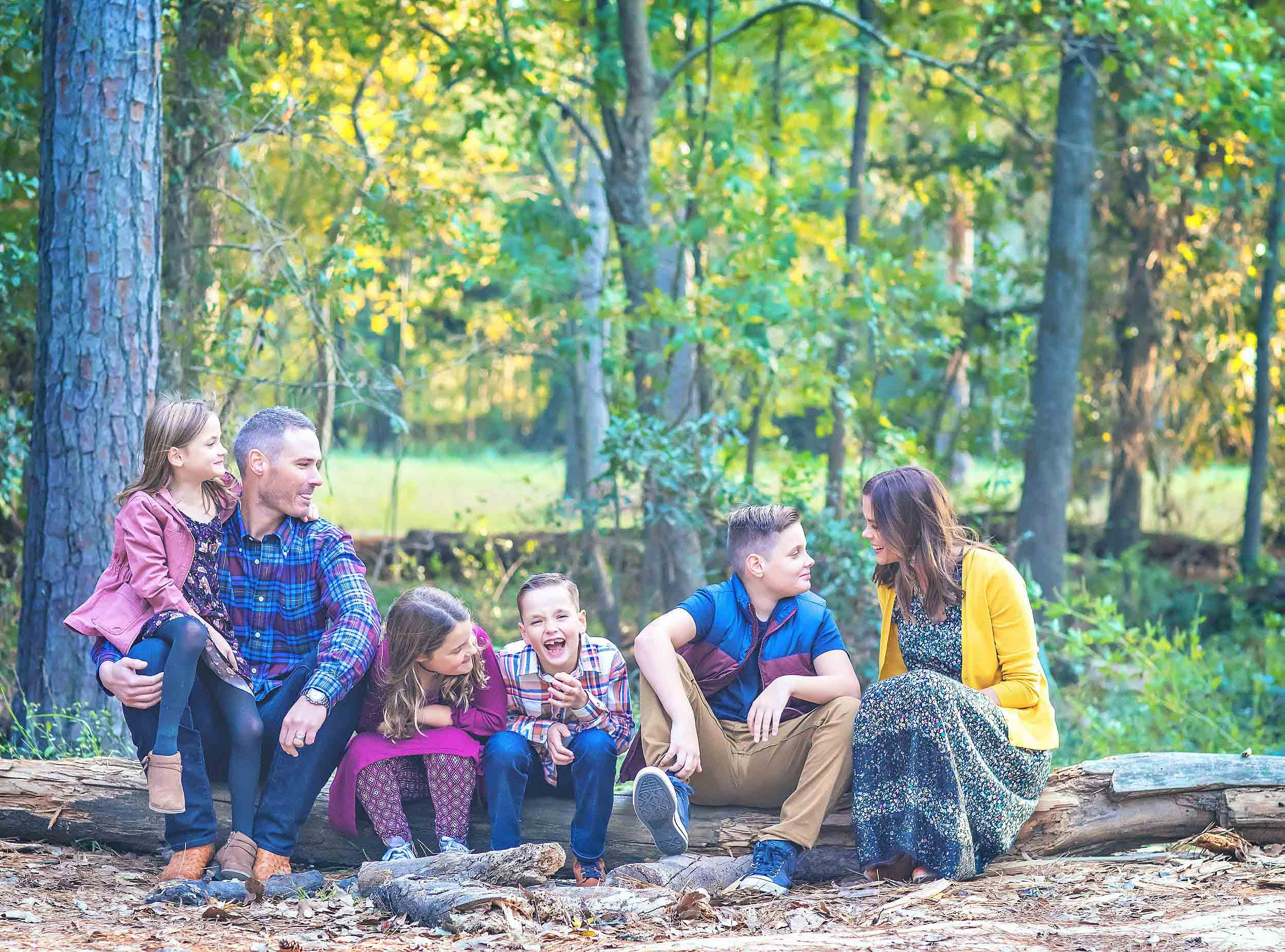 Outdoor lifestyle portrait of family in the woods in The Woodlands, Texas.