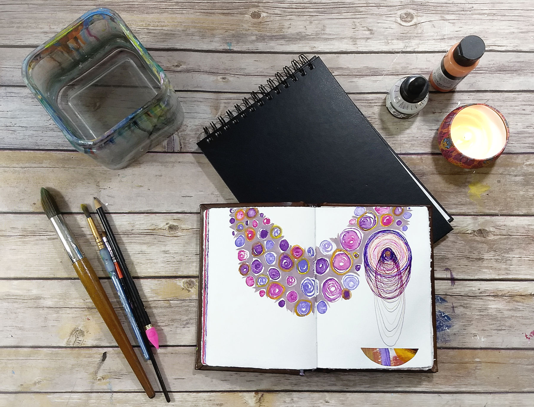 Join the Creative Practice Circle, live-online (image: Art table with art journal | Hali Karla Arts)