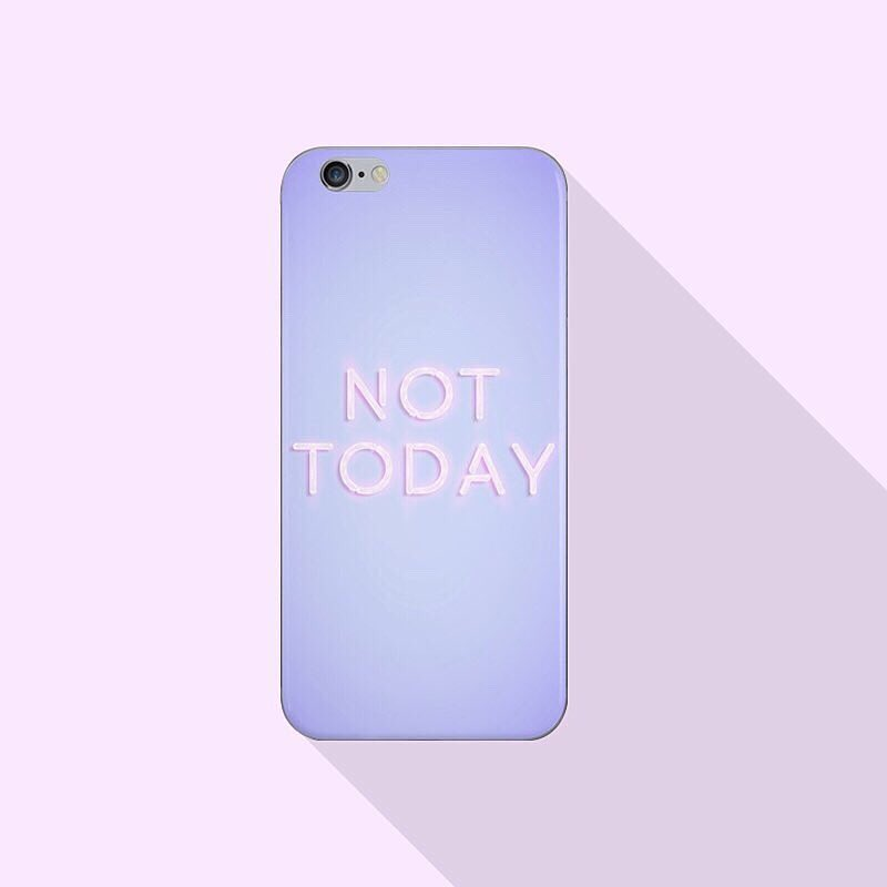 "The back of a smart phone with neon letters that spell out, ""Not today."""