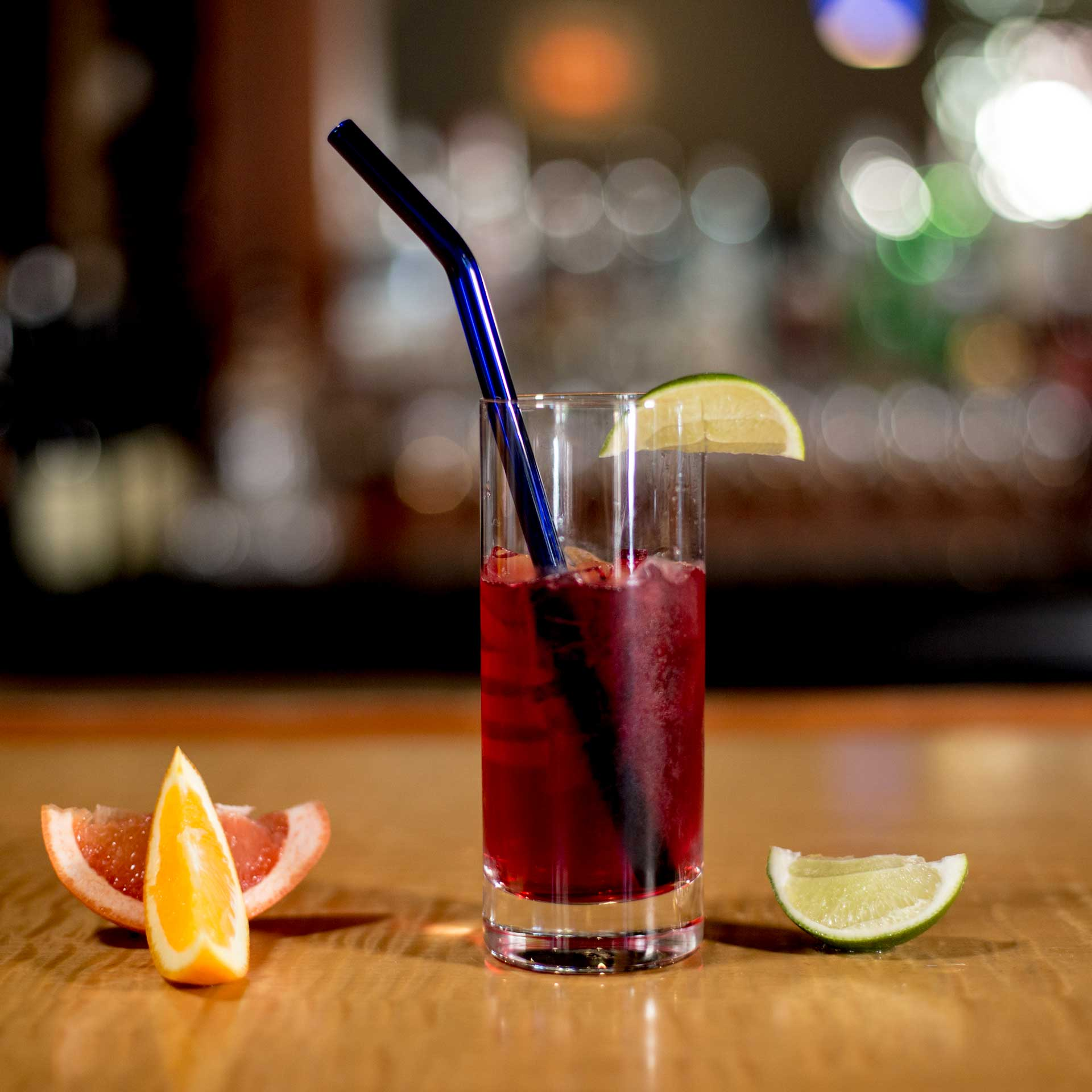 EcoGlassStraw_Bent_blue_lime_TallGlass_orange_Lemon_RedDrink.jpg