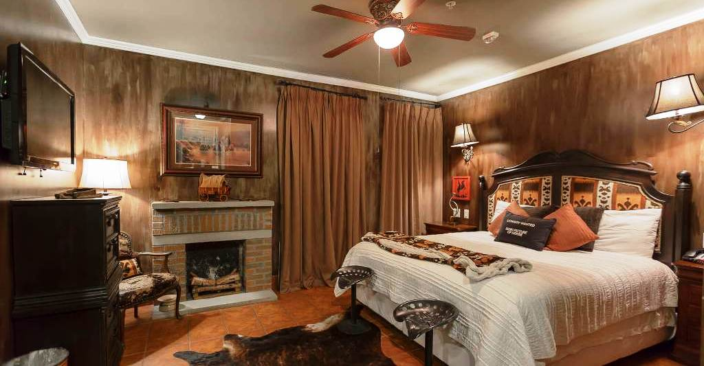 The Cowboy Room - Celebrate your day by waking up in this country themed room. Ceramic tile floor. Raised bath floor.