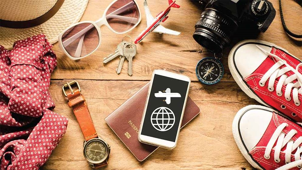 travel_app_on_mobile_screen_surrounded_by_objects.jpg