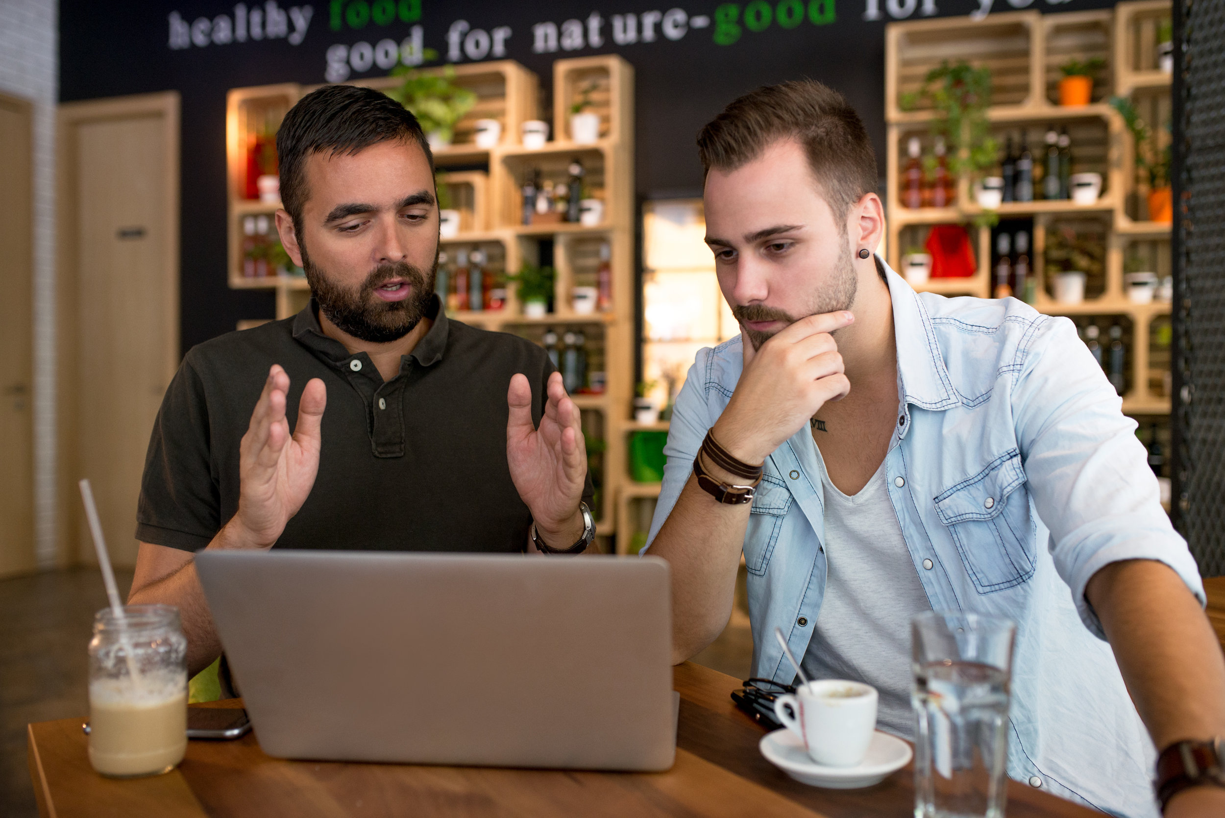 Website designer talking to client