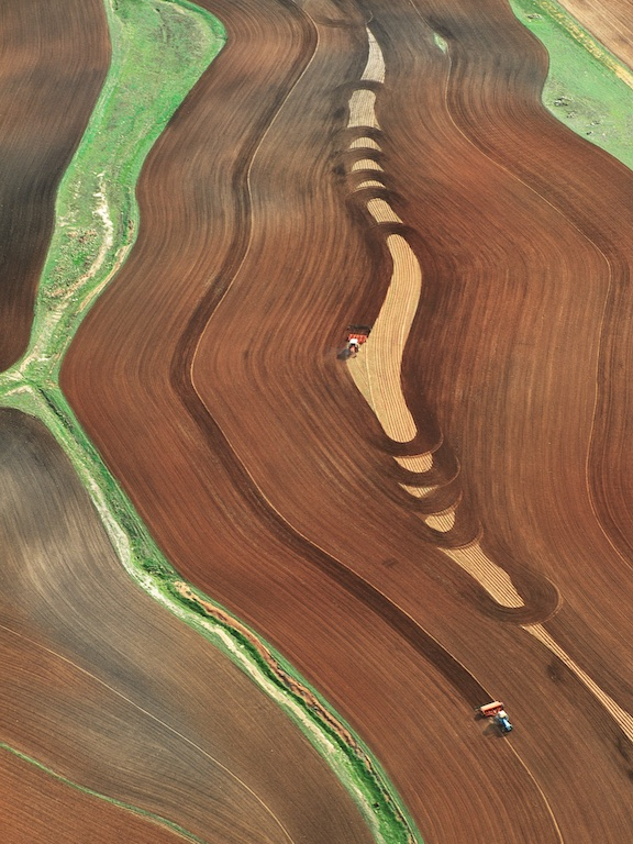 Tractor ploughing wheatfield, Northam, Western Australia, 1992.