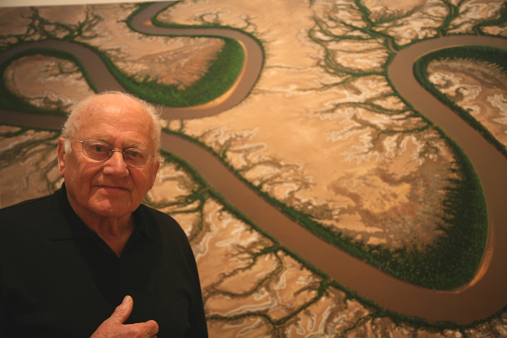 Richard Woldendorp in front of one of his aerial photographs