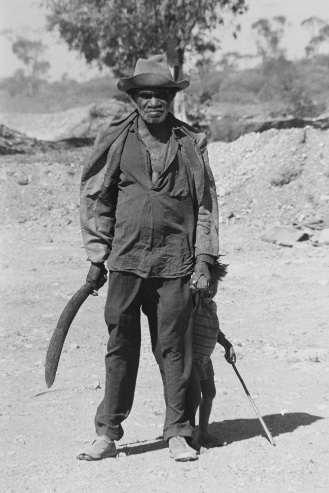 Aboriginal man with child, Meekatharra WA  c.1963