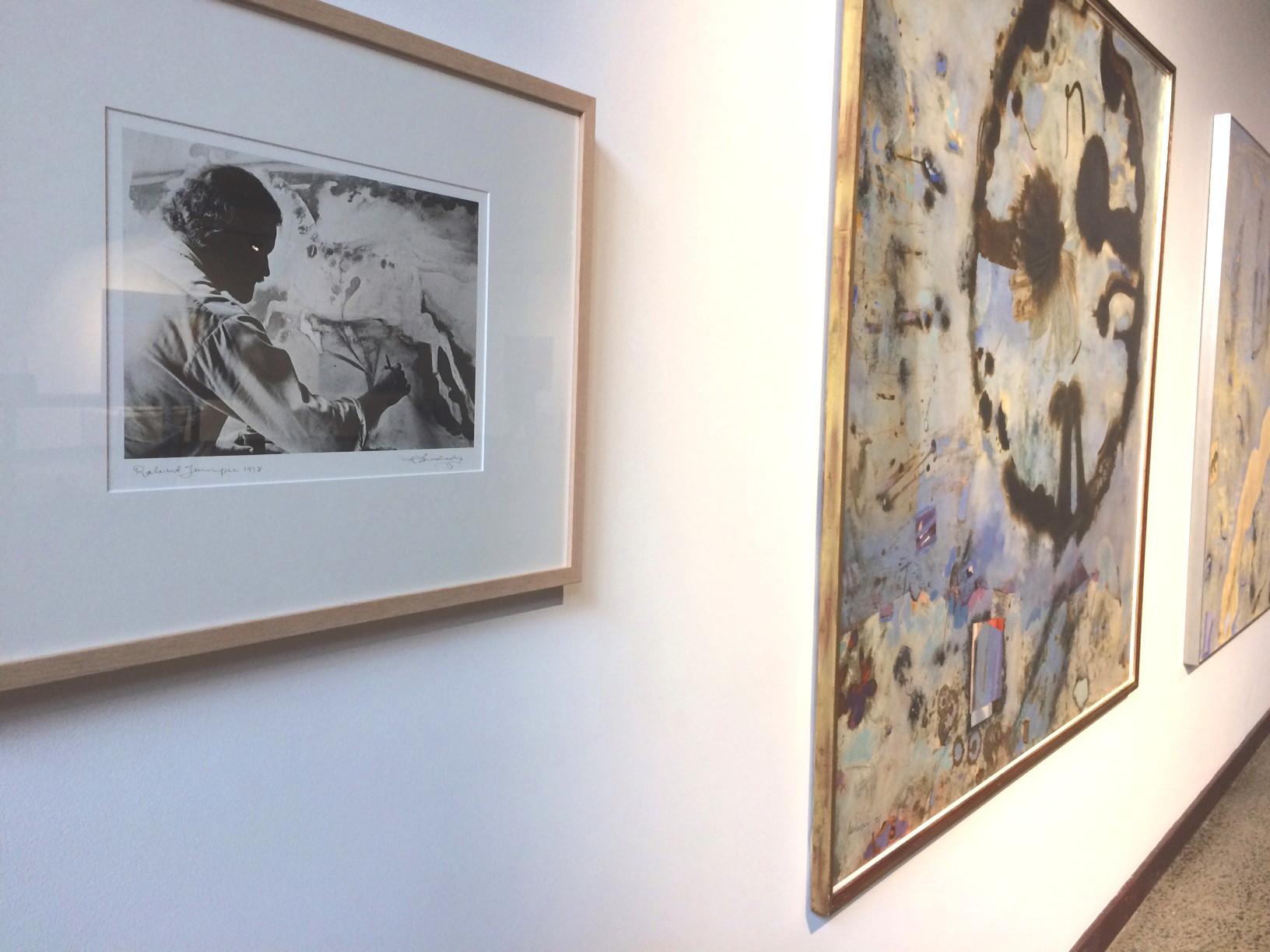 Richard's portrait of Robert Juniper next to some of Juniper's paintings