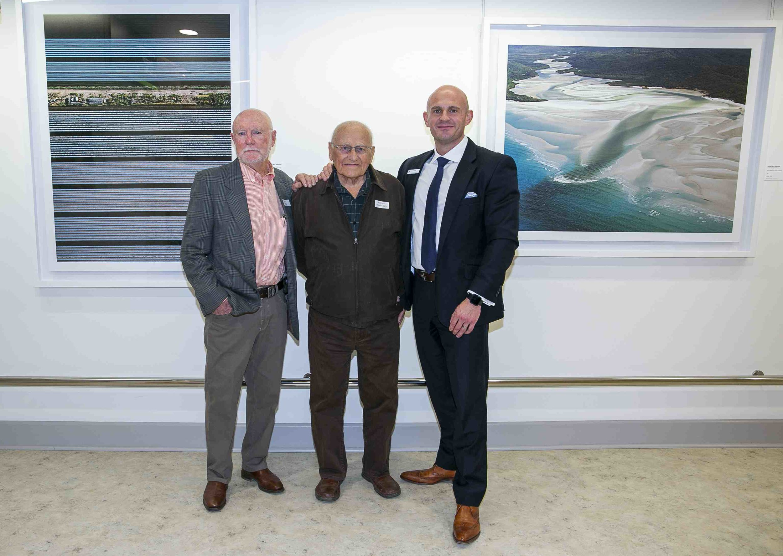 Richard Woldendorp at the 'Meet the Artist' opening with CEO of St John of God Hospital, Ben Edwards on his left, and Richard's long time friend and pilot, Jan Ende on his right.