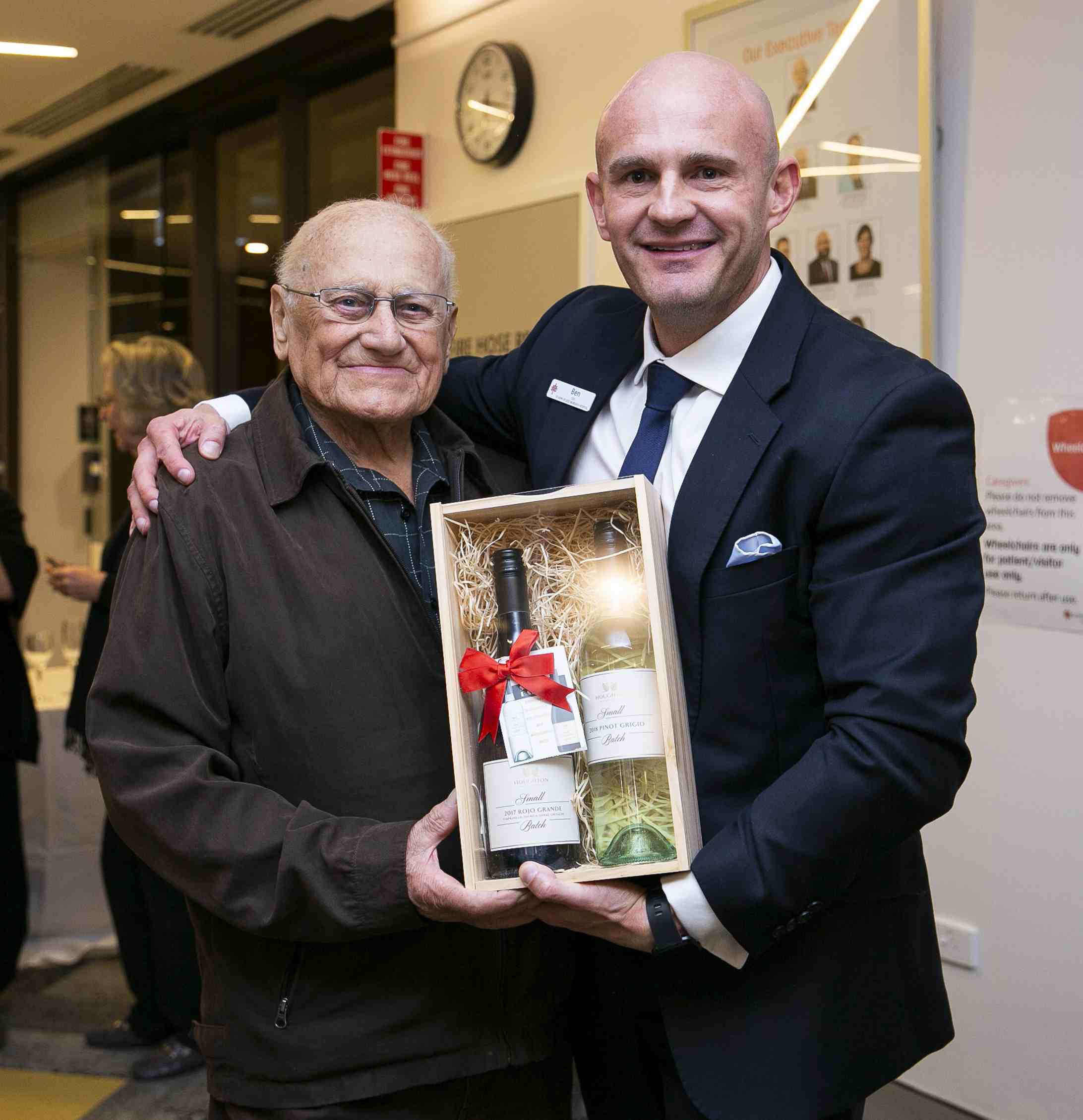 CEO of SJOG Hospital Ben Edwards presents Richard with a gift.