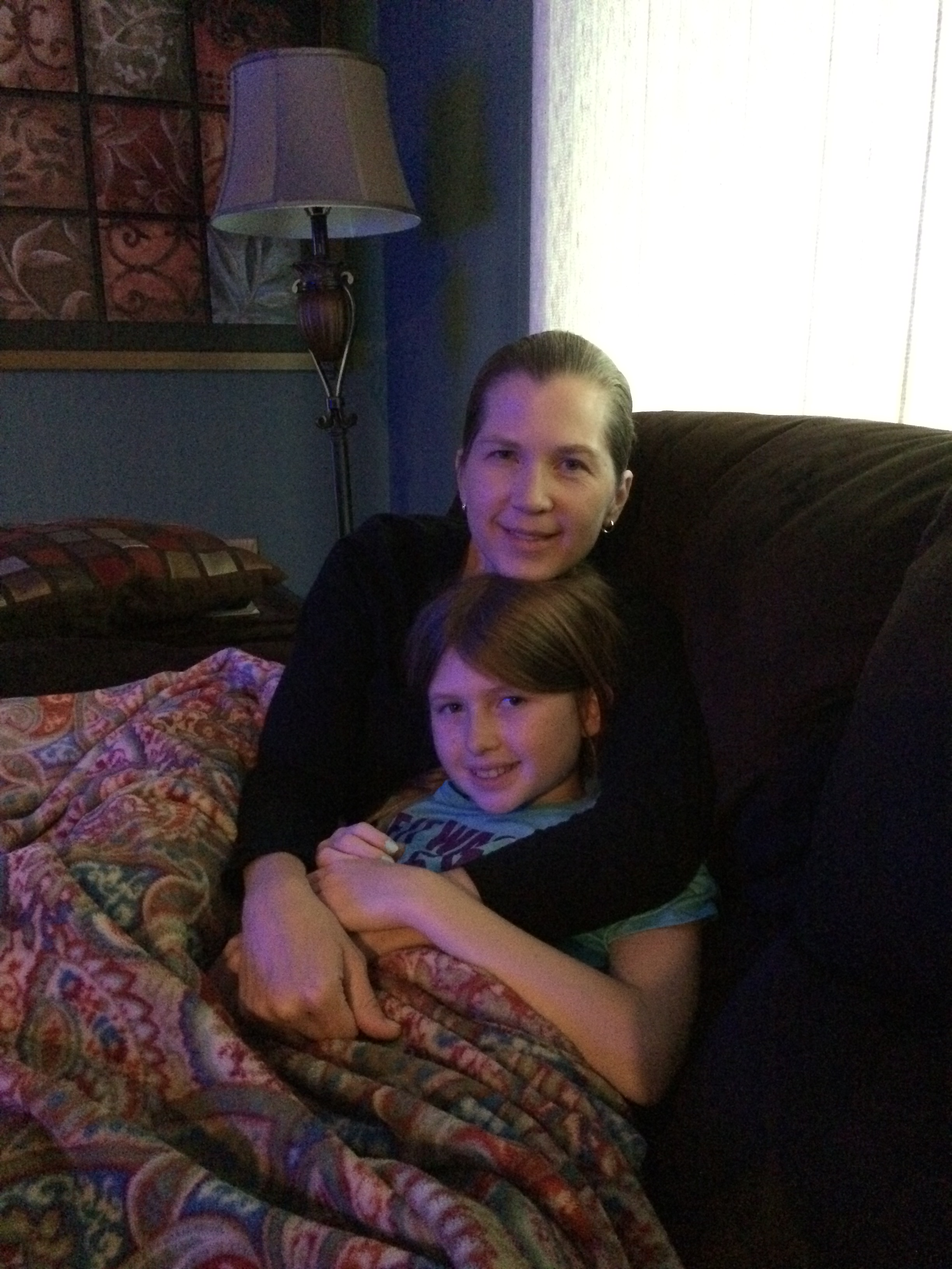Cuddling on the couch with my favorite patient. Mommy hugs are an integral part of the healing process.