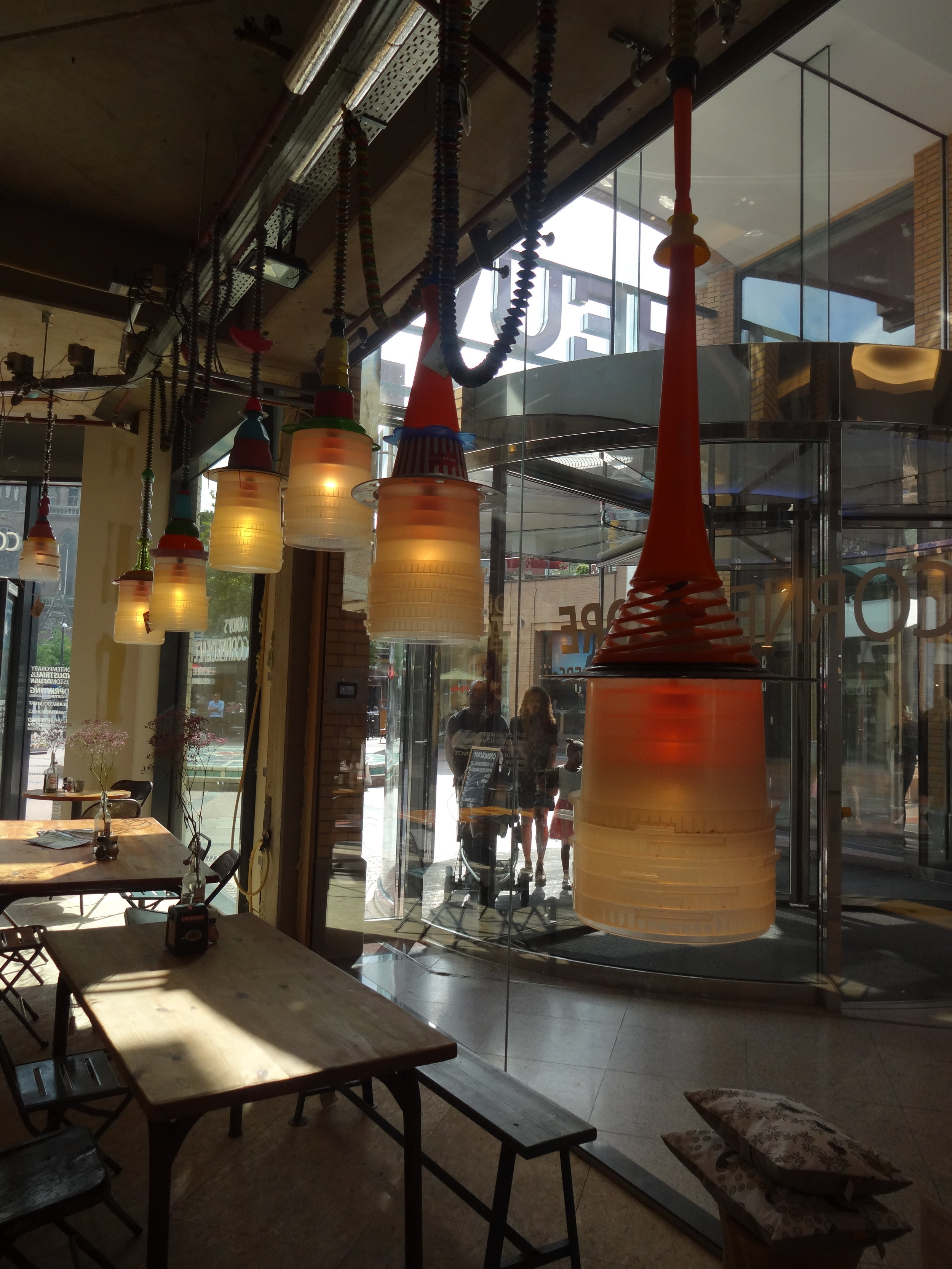 - The bucketlights create a great atmospere in the CornerCafe. Designed by Much2C, made from reused plastics.