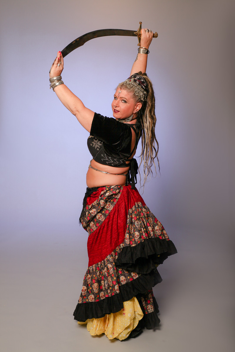Patti Chiarini - Patti has been belly dancing for over 10 years. Starting in Cabaret she quickly became drawn to the fusion side of belly dance and improvisation. Patti is certified as an ATS® instructor and soon to be Fly Fusion® instructor. She strives to help women have a positive body image and that every woman regardless of shape, size, or age can dance and look beautiful doing so.