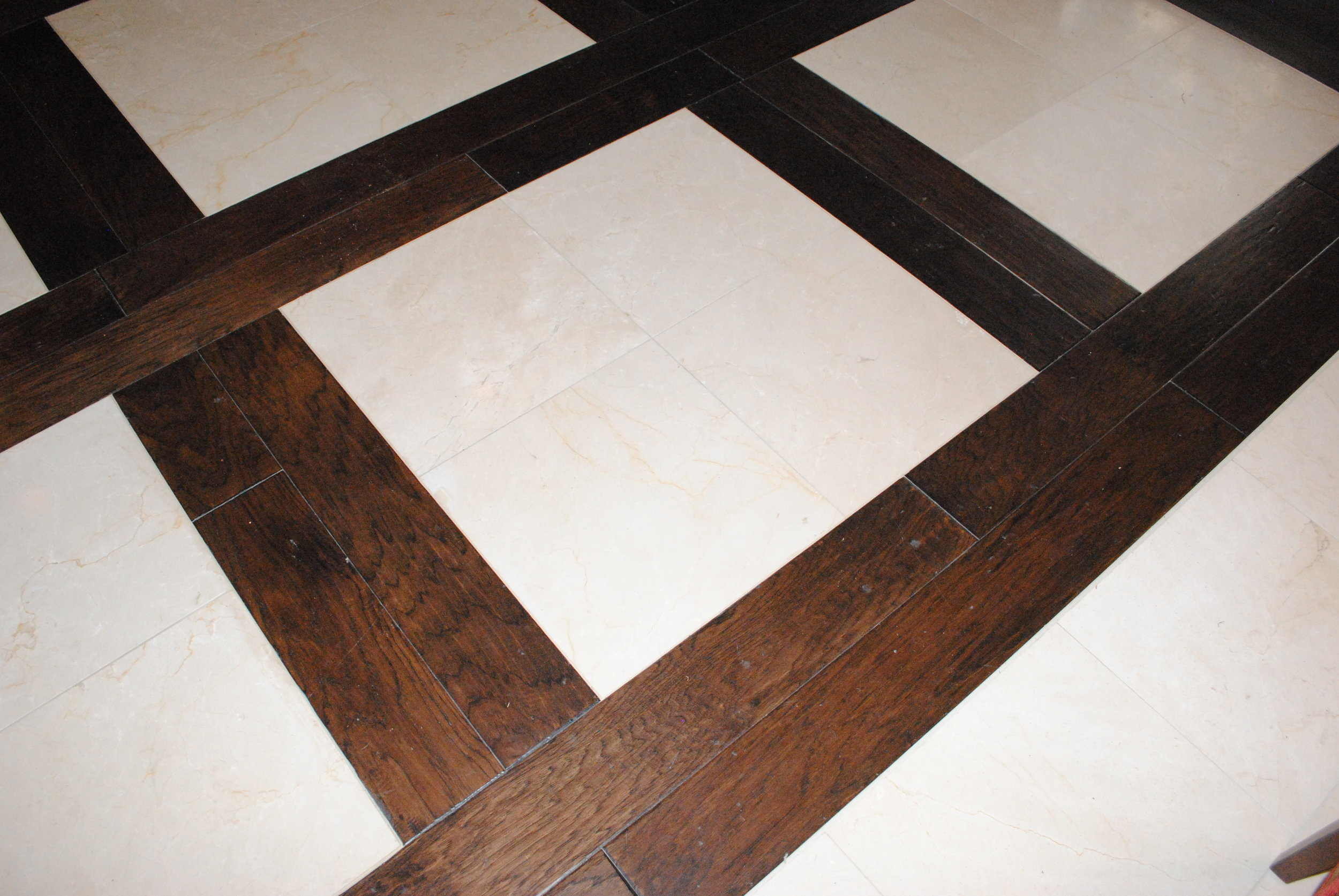 Hardwood floors with tile inlays