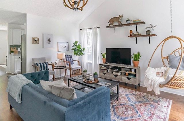 Question: when you start planning the style of a room, do you pick out the sofa first, or the rug? With this room, we picked out the rug first (that I still drool over) then picked a pretty color from the rug and along came Mr. Blue Sofa. 🛋 But don't let me fool you - we really planned this entire room around the kitty cat.🐆 . . . . .  #wildcatinterior #howyouhome #vignette #homestaging #howwedwell #relaxing #homedecor #interiorstylists #interiordecorating #greenery #apartmenttherapy #housetour #naturelovers #naturallight #earthinspiredhome #interiorstaging #taxidermy #interior123 #nashvillestaging #magnoliahome #dreamhome #interiordecorators #nashville #realestate #nashvillerealty #housebeautiful #transformation #thedecorsocial