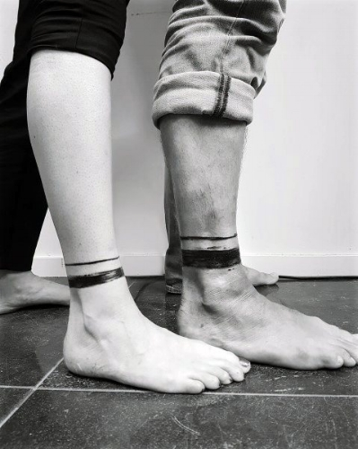 cool-couples-tattoos-lower-leg-black-ink-leg-band-design.jpg