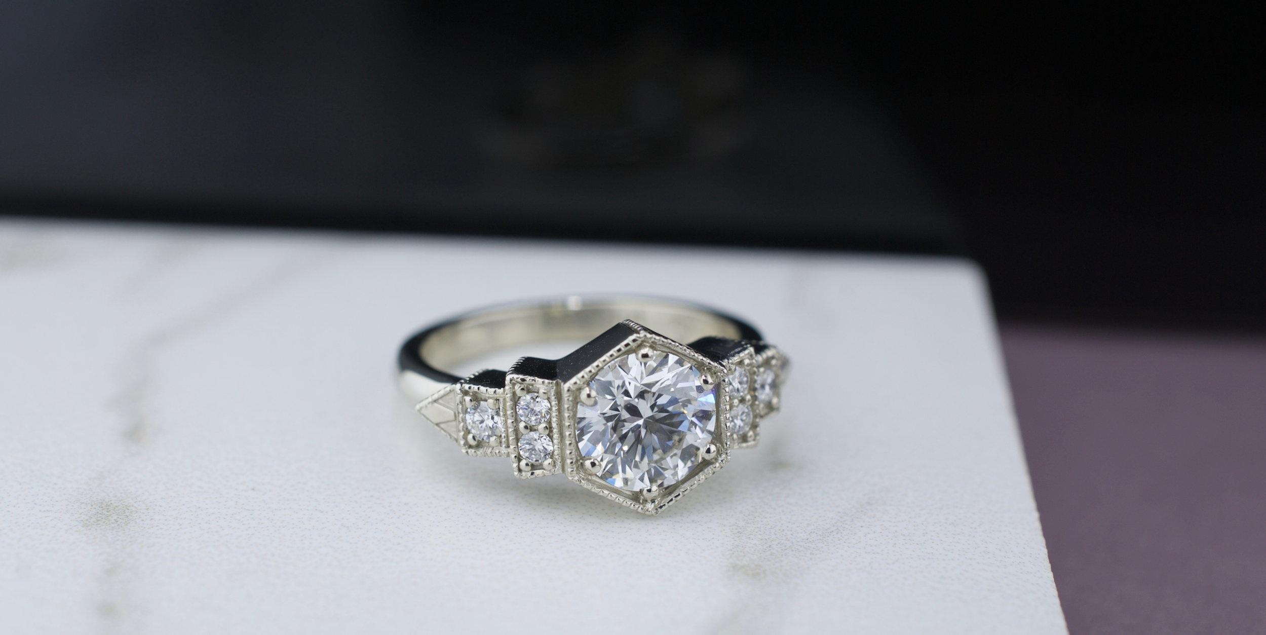 alexandrea-white-gold-diamond-heptagon-geometric-marble.jpg