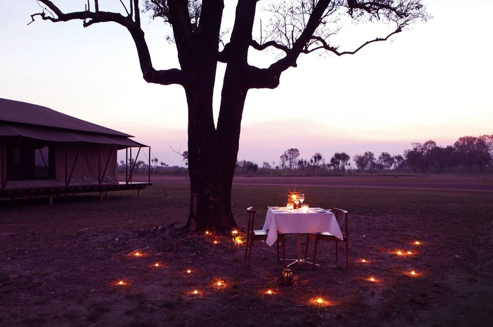 Outdoor dining at Wildman Wilderness Lodge, Northern Territory