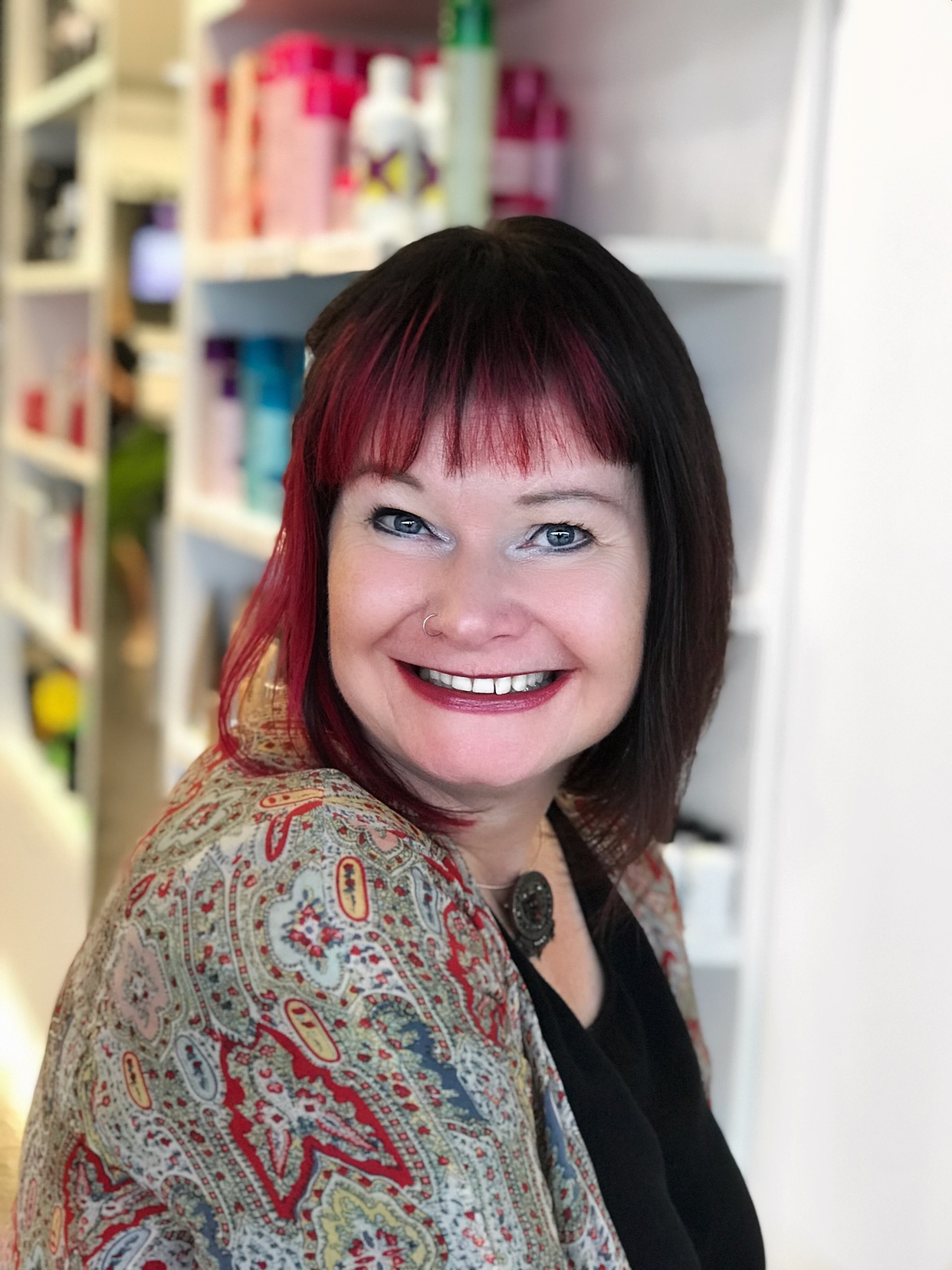 """Emma started hairdressing at the young age of 40. She joined the Silver Scissors team in February 2015. Since joining Silver Scissors Emma has proven to be a valuable member of the team bringing with her maturity & a natural ability to connect with the clients. She also helps behind the scenes with Marketing & Promotional work for Silver Scissors. Nothing makes Emma happier than an Avant Garde colour coupled with an alternative haircut. """" I am excited about the hairdressing industry it's great to have a new challenge. To be a truely great hairdresser it takes application & dedication & with the help of all the training on hand at Silver Scissors from all my caring & sharing co-workers it's achievable."""" . If you want to stand out in a room Emma is your hairdresser! Emma is also a member of The Schwarzkopf Made To Create Team."""