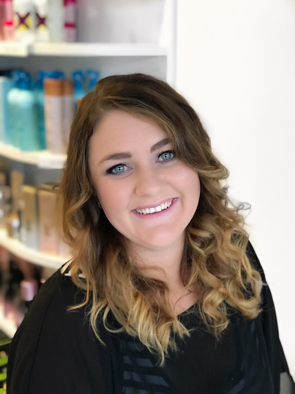 """Kelsie is a Creative Stylist with 6 years of experience in the industry. She joined the team at Silver Scissors in early 2013 & hasn't looked back. Kelsie enjoys all aspects of hairdressing, particularly long hair work & soft colouring. She is a very clever colourist, a great mens cutter, does a beautiful hair-up & her long hair blow waves are to die for. In fact, she's a great all rounder. """" I love making people feel great about themselves, doing a colour & cut & watching them leave the salon feel amazing."""" Kelsie is of a bubbly disposition & has an excellent raport with all her clients, she is attentive & will ensure you have a fantastic hairdressing experience."""
