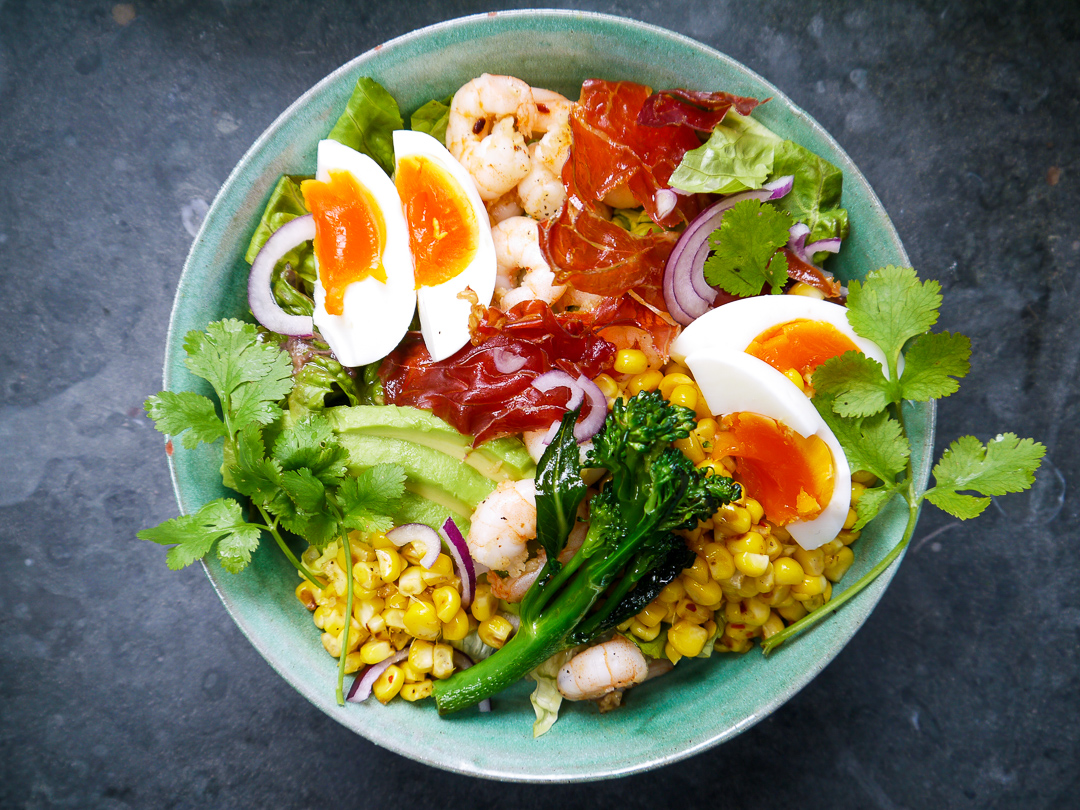 california cobb (gf) £8 - £8 per person or £38 for a platter for 5Clarence Court jammy egg, chilli prawns, griddled sweetcorn, chopped farmers market greens, pickled onion, coriander, and a lime dressing. summer in a bowl.
