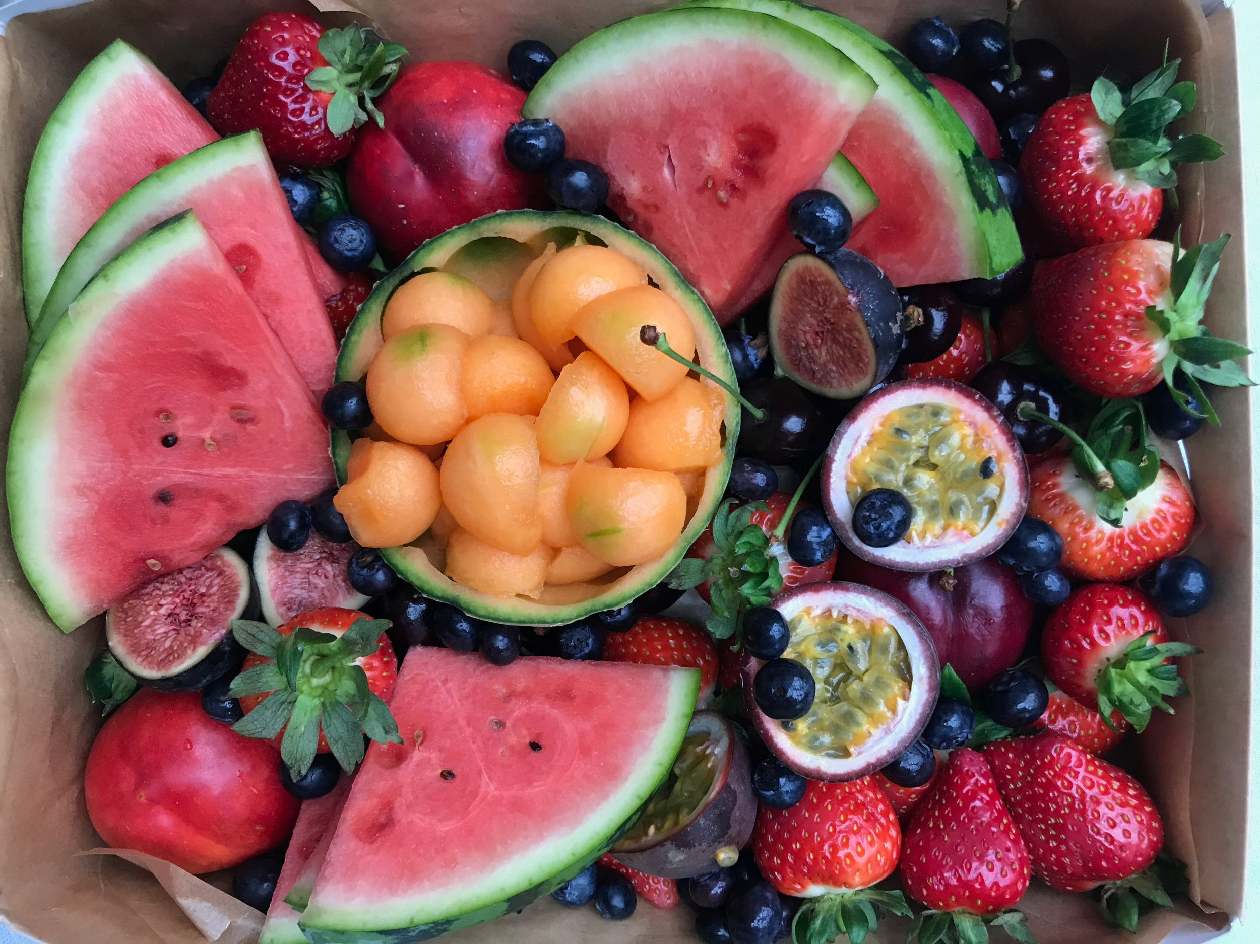 seasonal fruit plate £35 - a bright fruity platter, filled with ripe seasonal fruit. perfect for sharing.