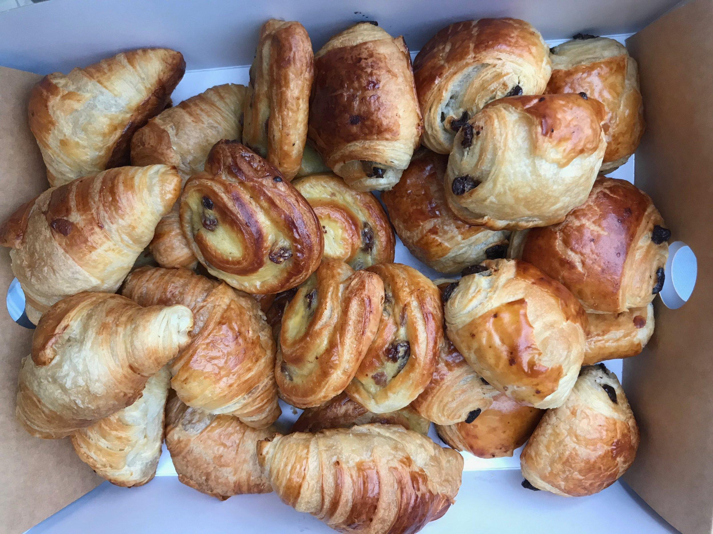 buttery mini breakfast pastries.box of 10 £10/ box of 20 £20 - all butter pain aux chocolats, pain aux raisins, croissants.