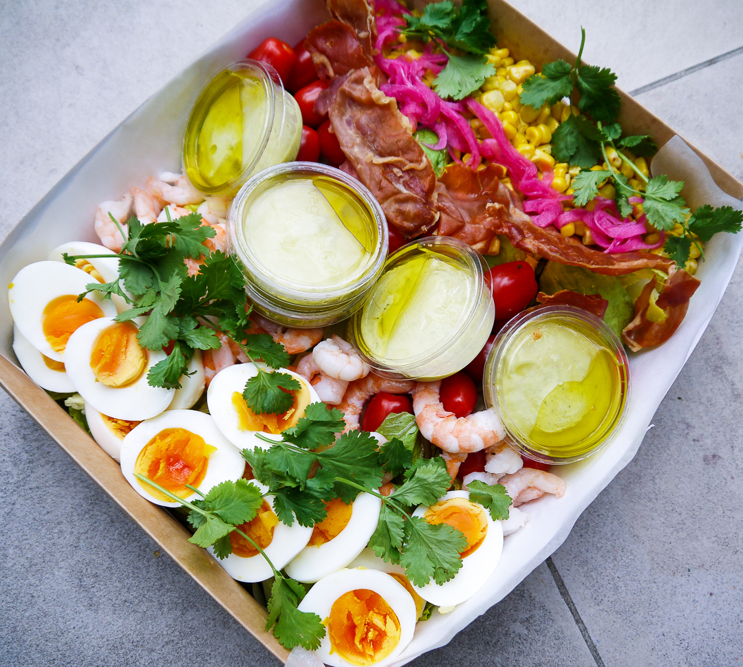 california cobb platter (gf) £42.50 - Clarence Court jammy egg, chilli prawns, griddled sweetcorn, chopped farmers market greens, pickled onion, coriander, and a lime mango dressing. summer in a bowl.