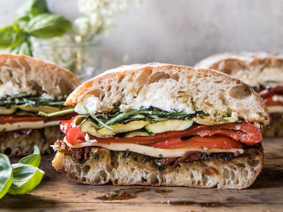 grilled vegetable and fresh pesto ciabatta £5.5 - freshly baked ciabatta, stuffed full of grilled, marinated vegetables, rocket, parmesan, pesto and drizzled with extra virgin olive oil. add in chicken for extra protein.add chicken +£1.5 | add hummus +£1.5