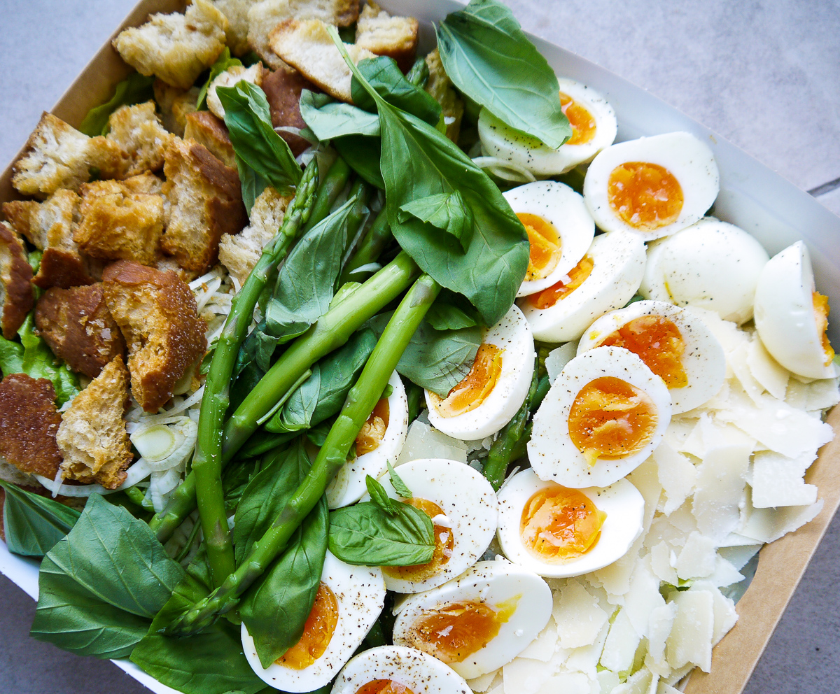 green eggs, no ham (veggie, gf). platter for 5:£40 - £8 per person or £40 for a platter for 5jammy egg, asparagus, basil, parmesan and sourdough croutons with a caesar dressing and seasonal greens. the classic, tweaked.add chicken + £1.5