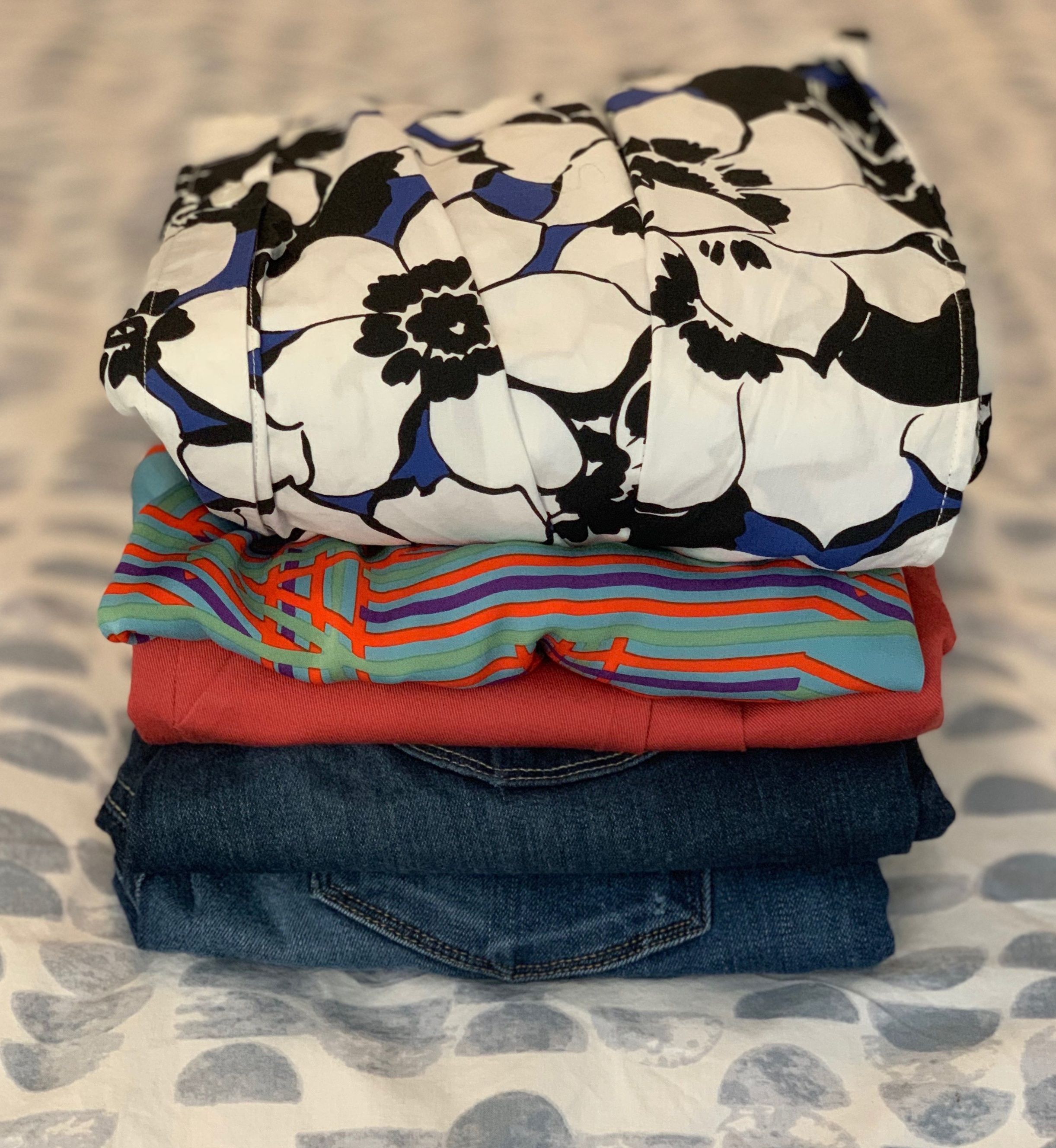 One in, one out! The pile of items for consignment after picking up some new tops.