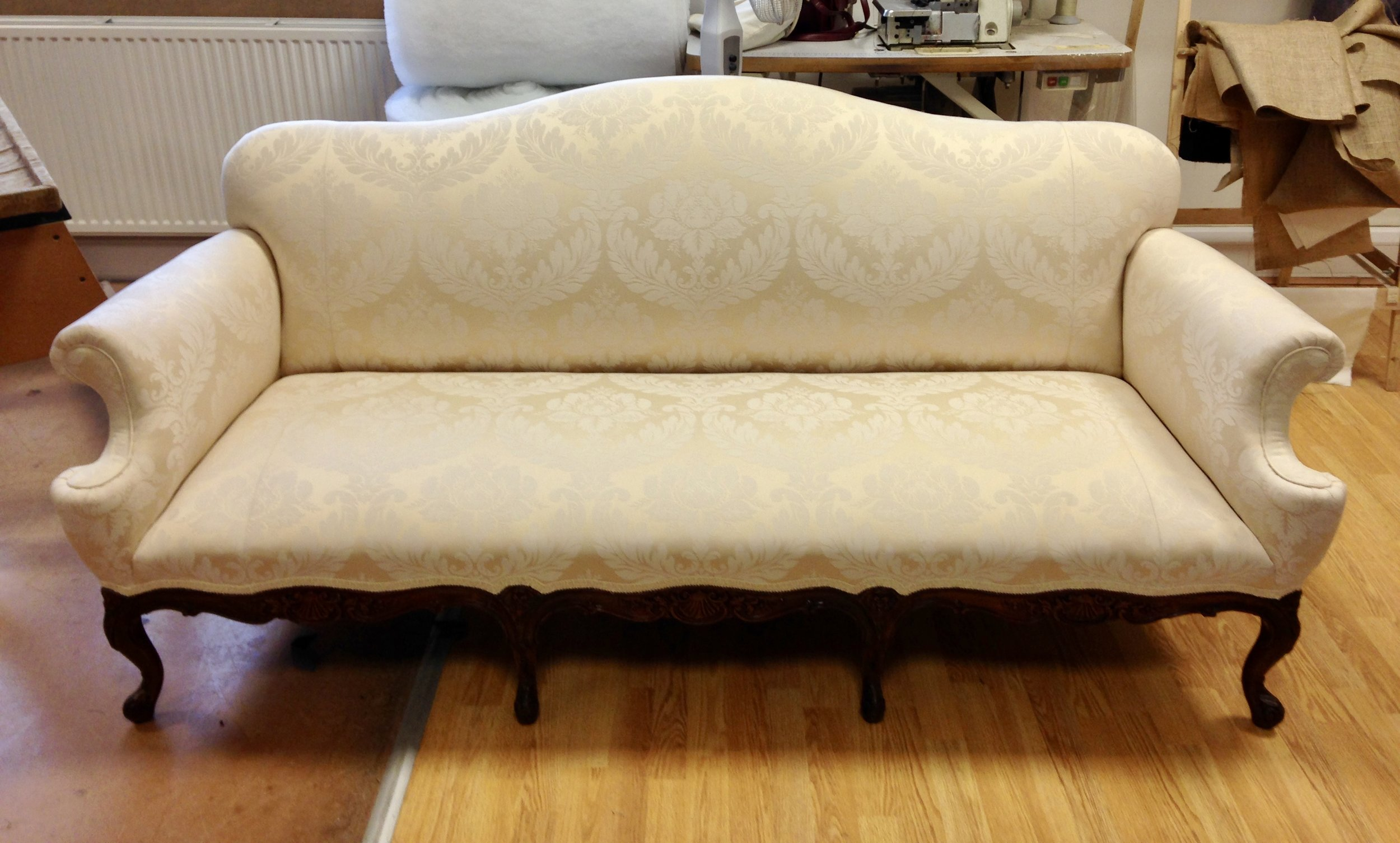 French style sofa, in cream damask. Traditional upholstery.