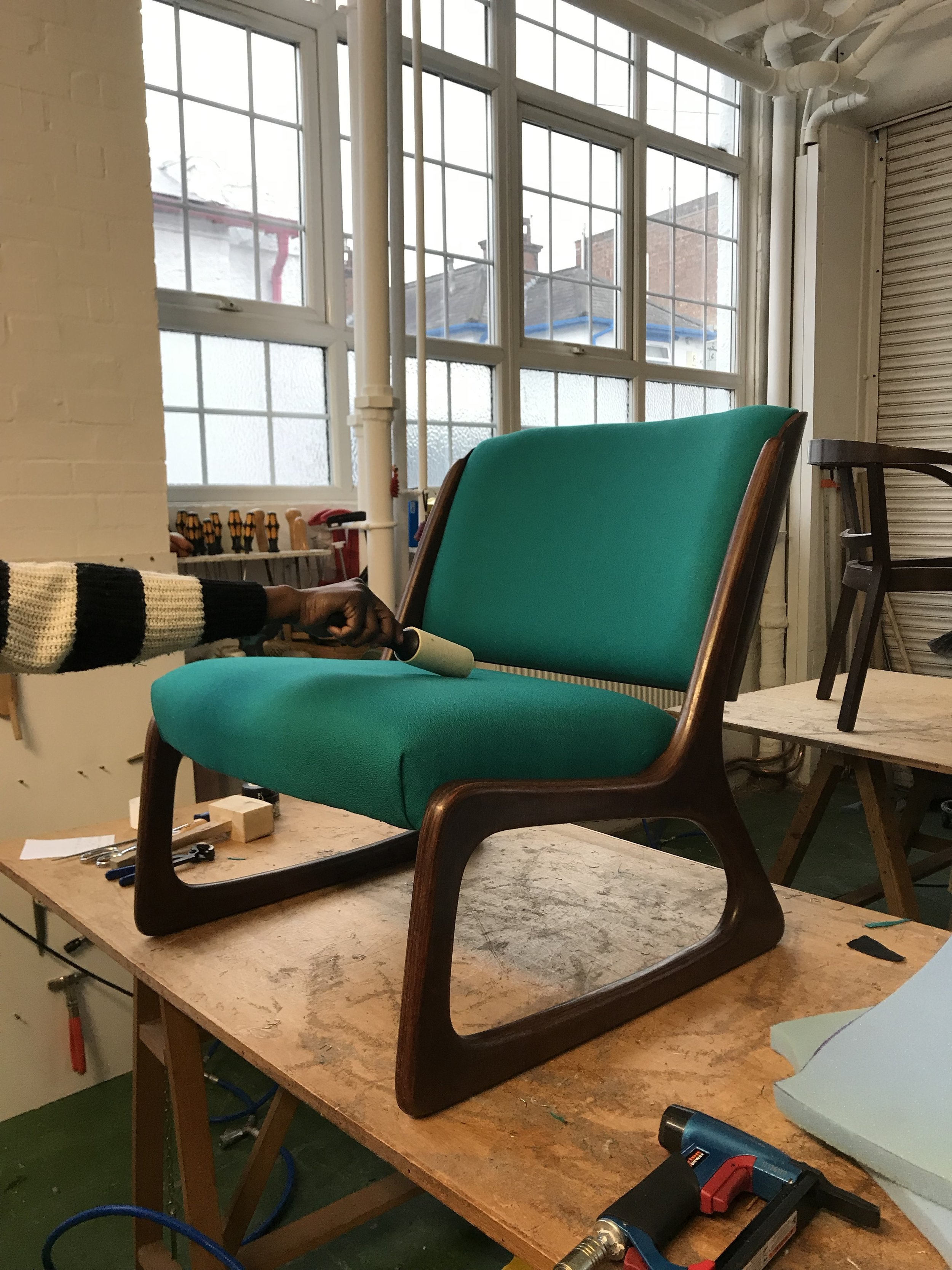 Gorgeous midcentury chair reupholstered in class at Edge Upholstery.