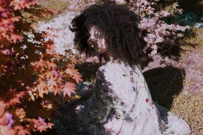 curly hair woman shadow.jpeg