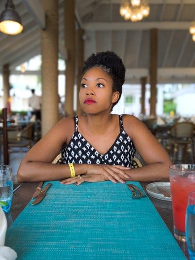 black woman at dinner table.jpeg