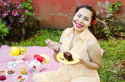 woman eating cake.jpeg