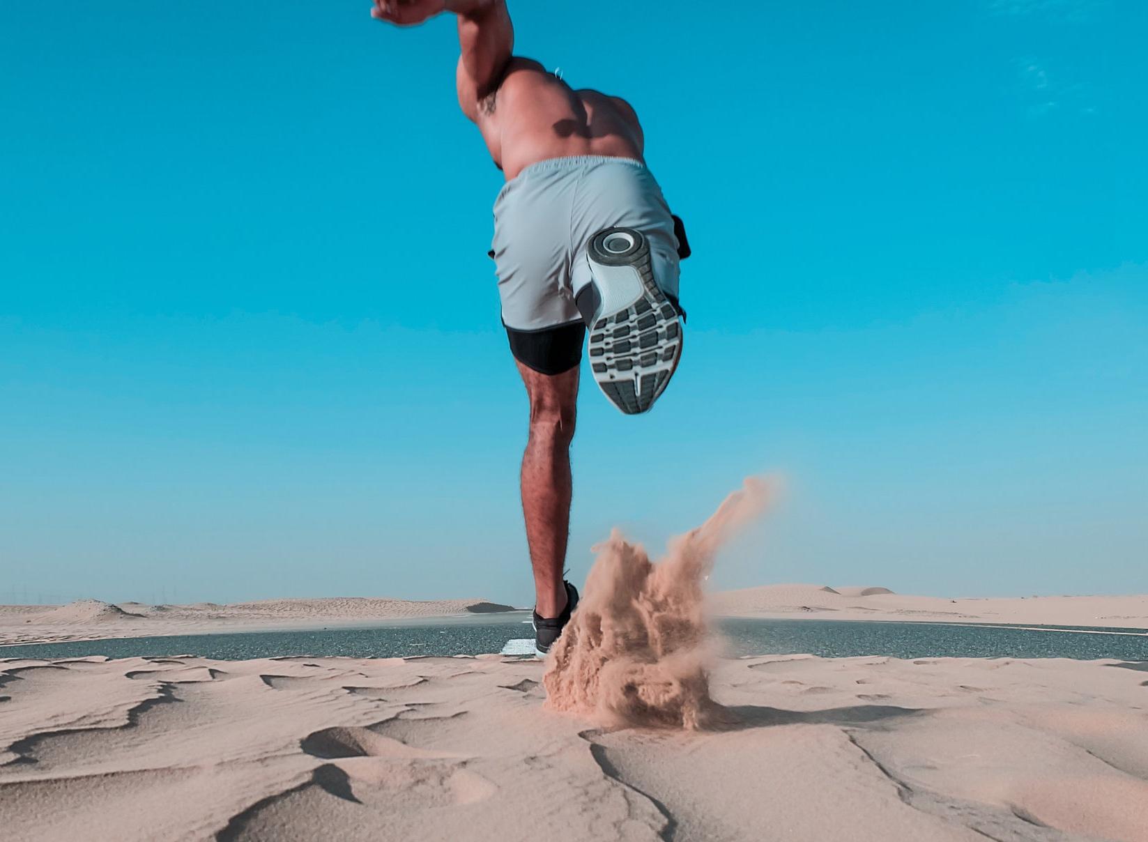 Canva+-+Man+Running+on+Sand.jpg