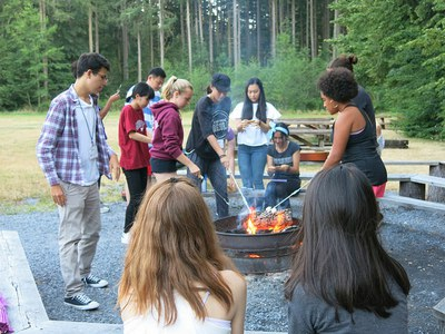 After an exciting day of games, activities, and skits, the group enjoyed some s'mores and songs around the campfire.