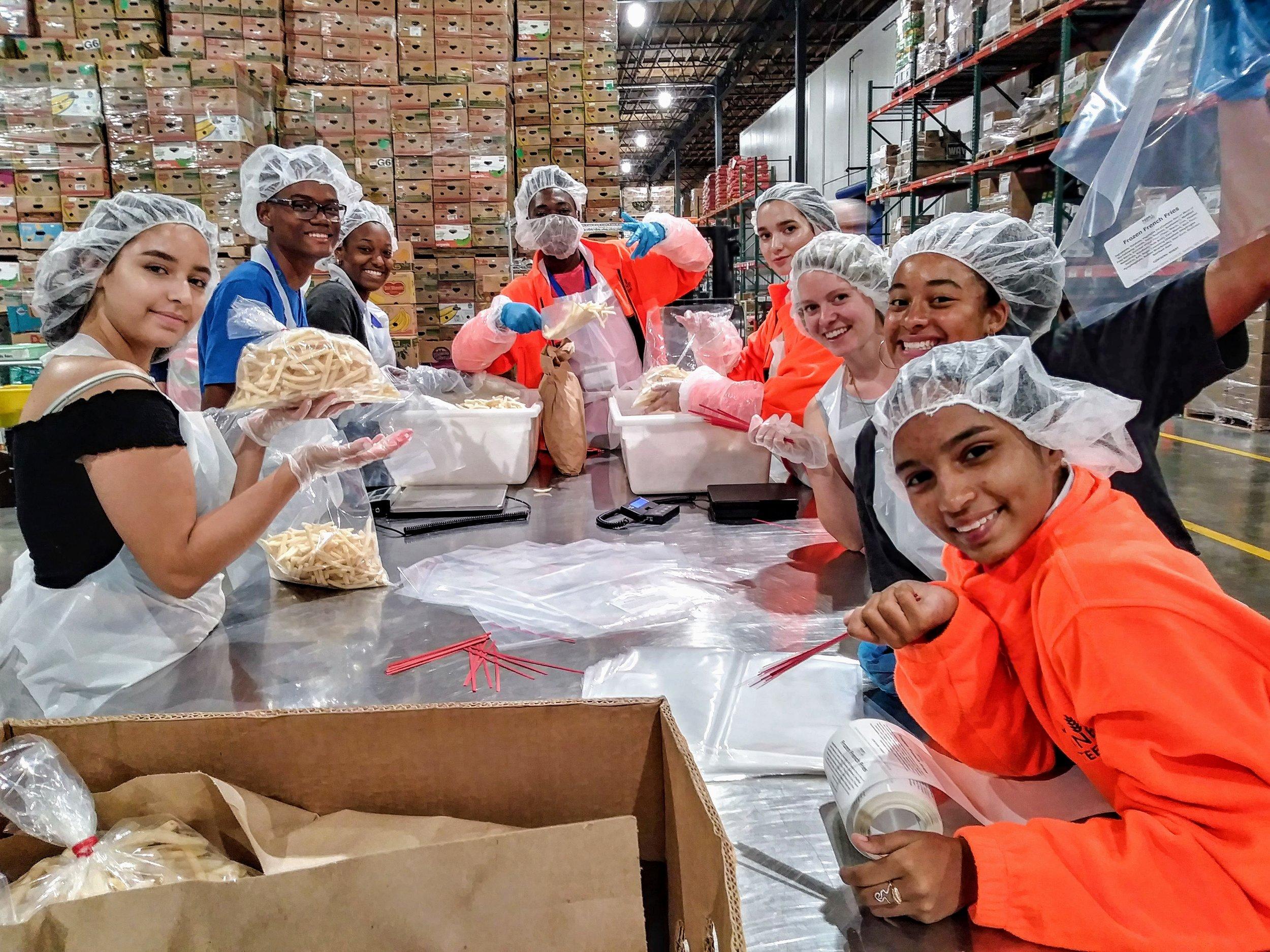 Caribbean 2018 Young Ambassadors and Local Young Ambassadors volunteering at Food Lifeline