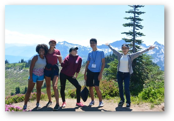 Nadine (far left) and SLCI friends on a hike at Mt. Rainier during the program retreat.