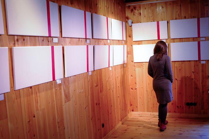 """Artist Fríða Dís Gudmundsdóttir displays her work, """"Próf/Tests"""" (translation: Exhibition/Tests) in Ljósanótt, Iceland. This exhibit depicts Fríða's journey through infertility. It took her and her husband 56 months and 56 negative pregnancy tests (i.e., one pink line) before becoming pregnant.  http://www.visir.is/g/2017170909511"""