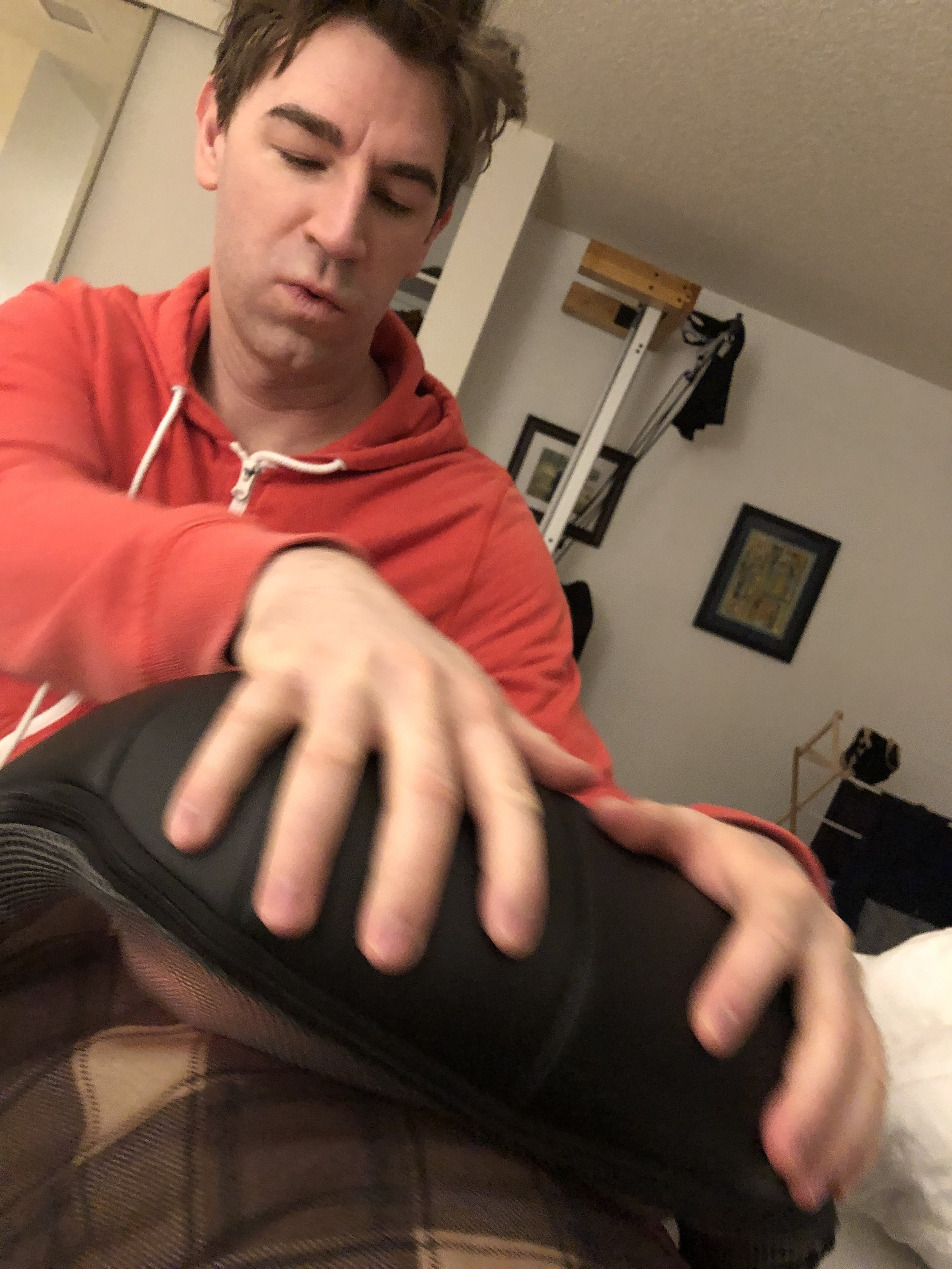 Cory massaging my injection site. First layer: heating pad. Second layer: fancy massager.