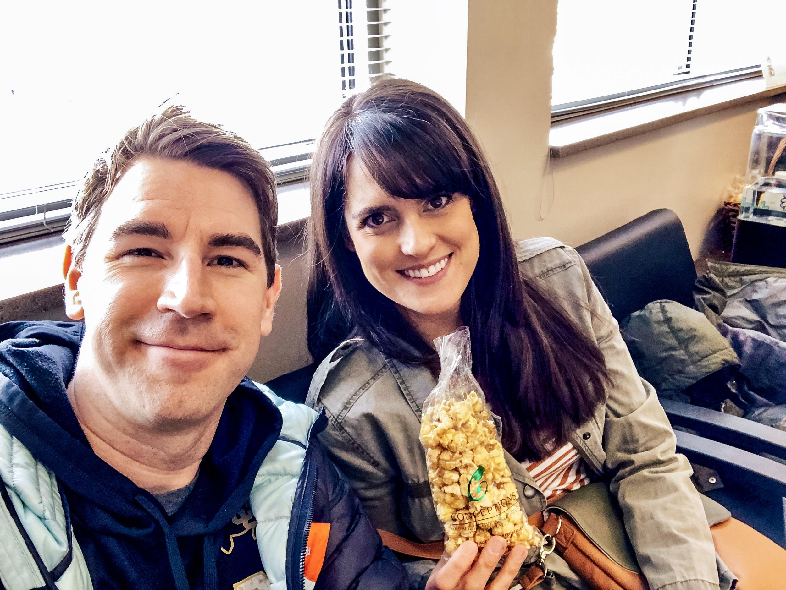 Cory and I sit in the waiting room at their Conceptions and have some of their signature caramel corn in honor of the burnt popcorn debacle that almost resulted in us cancelling this appointment.