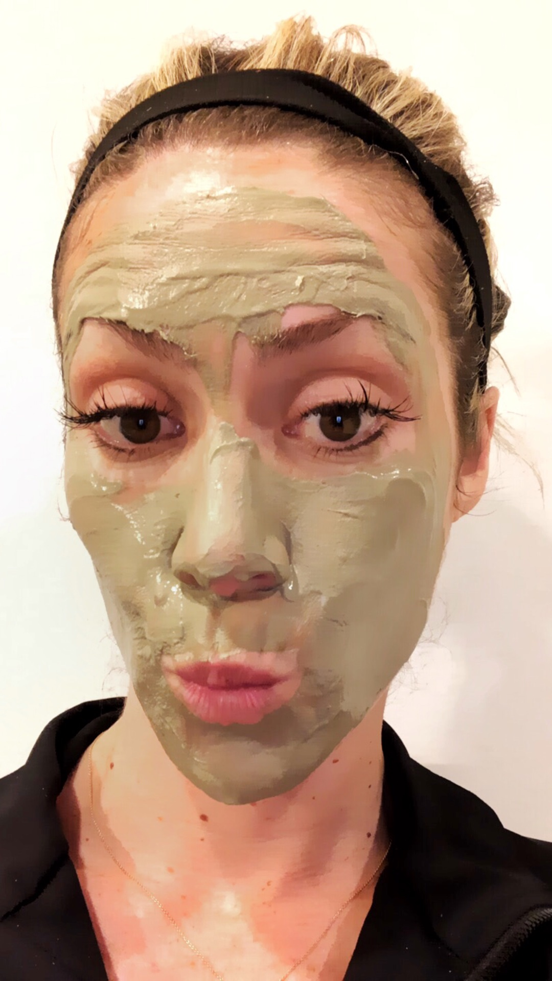 the DL: - Here you can see the mask is still wet on my forehead and right cheek but starting to dry on my left cheek. When it turns chalky is a good time to wash it off.