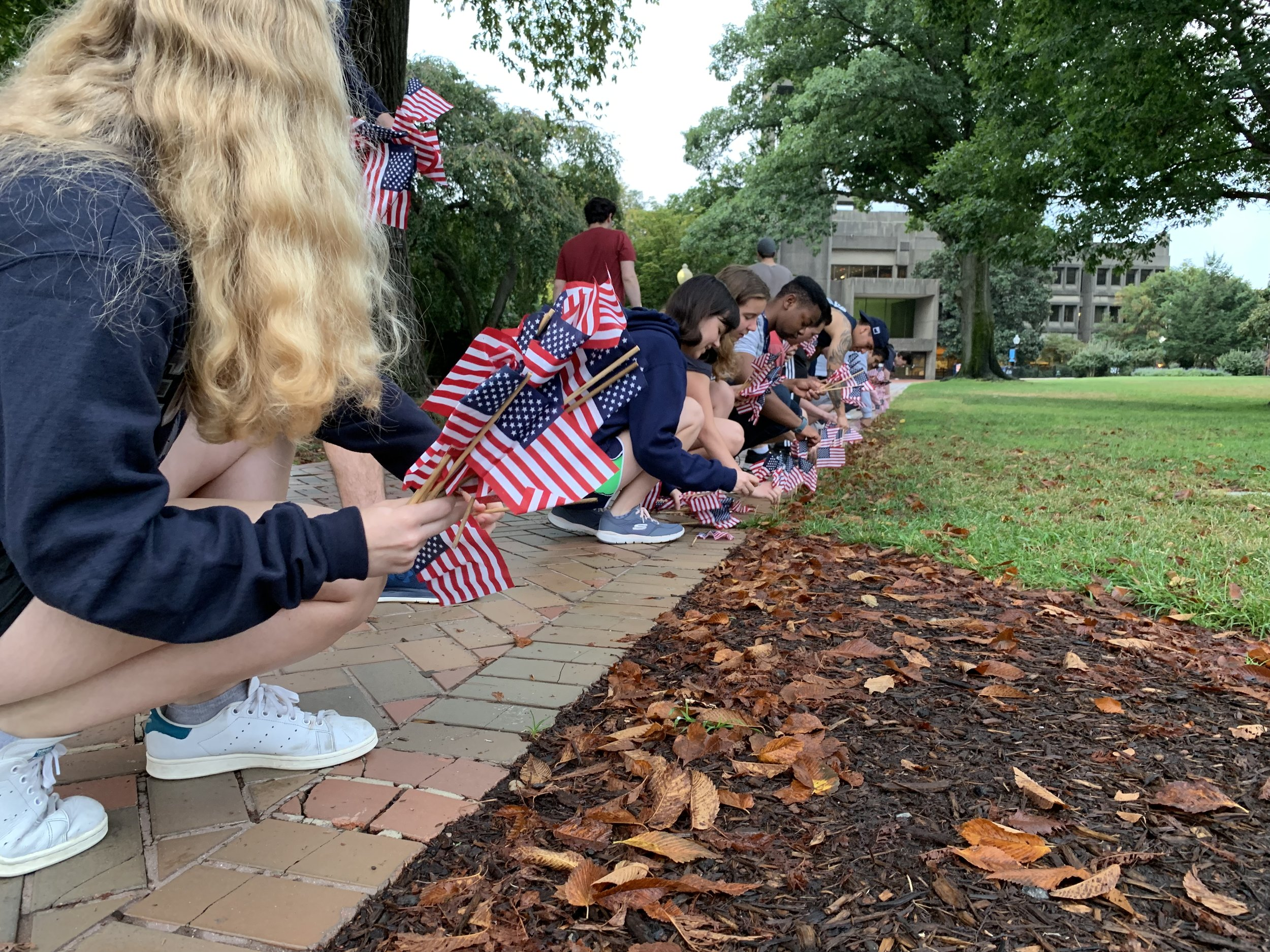 Georgetown students place American flags along campus sidewalks commemorating of the lives lost on the attacks of September 11, 2001. (9/11/2019)