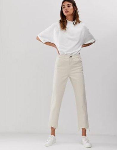 ASOS White cropped raw edge jeans, $100.00